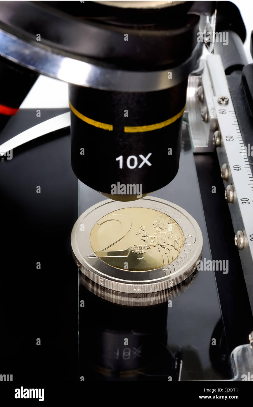 Euro currency in check under the microscope. - Stock Image
