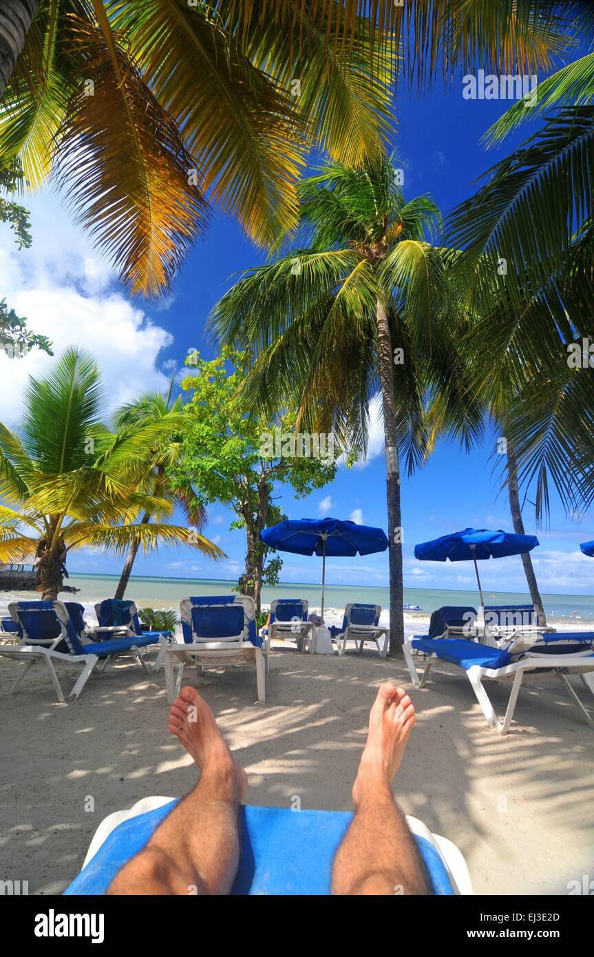tourist relaxing at the beach in exotic resort in saint lucia stock