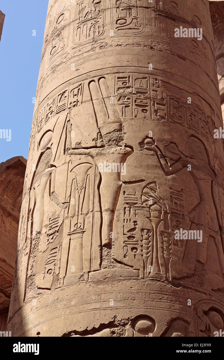 Min the Egyptian God of Fertility carved on a column in the Karnak Temple, Luxor, Egypt - Stock Image