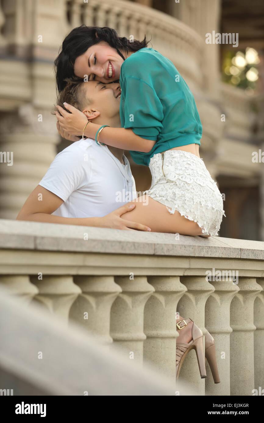 Woman embraces a man - Stock Image