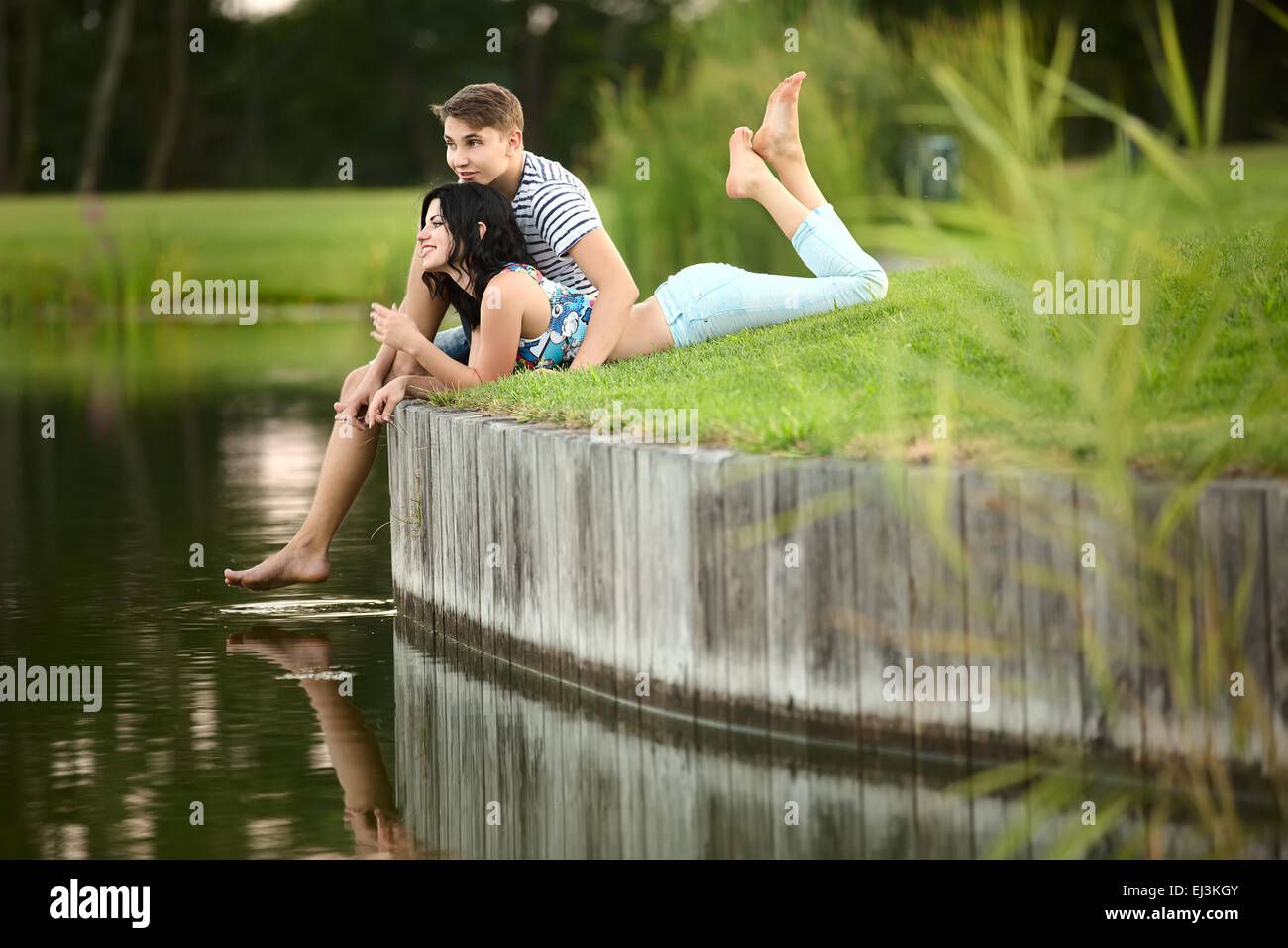 Young couple near water - Stock Image