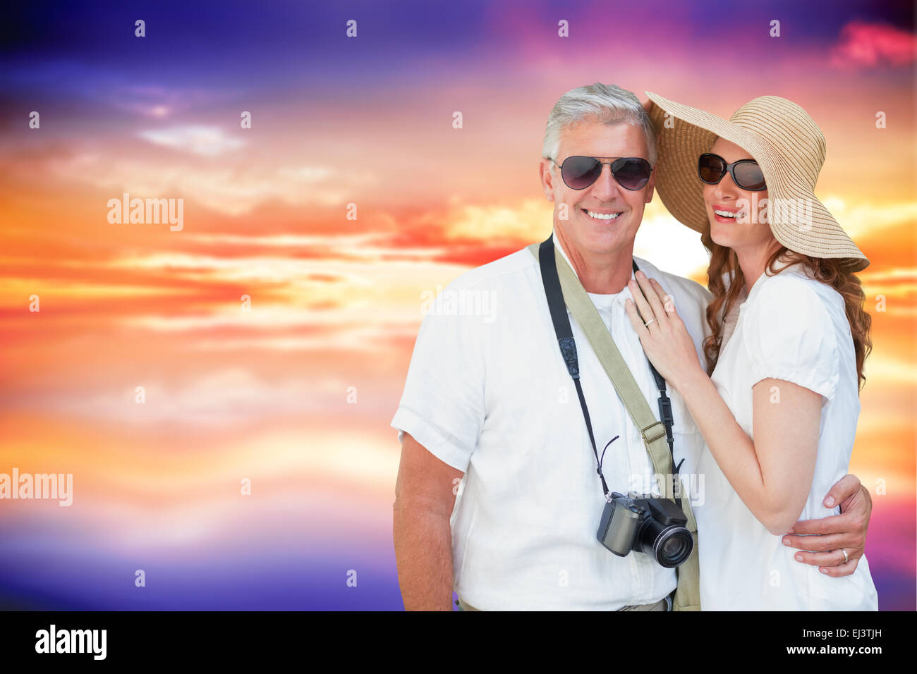 Composite image of vacationing couple - Stock Image