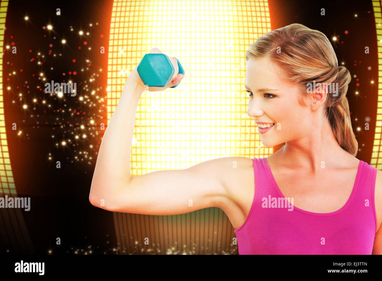 Composite image of fit blonde lifting dumbbell and flexing - Stock Image