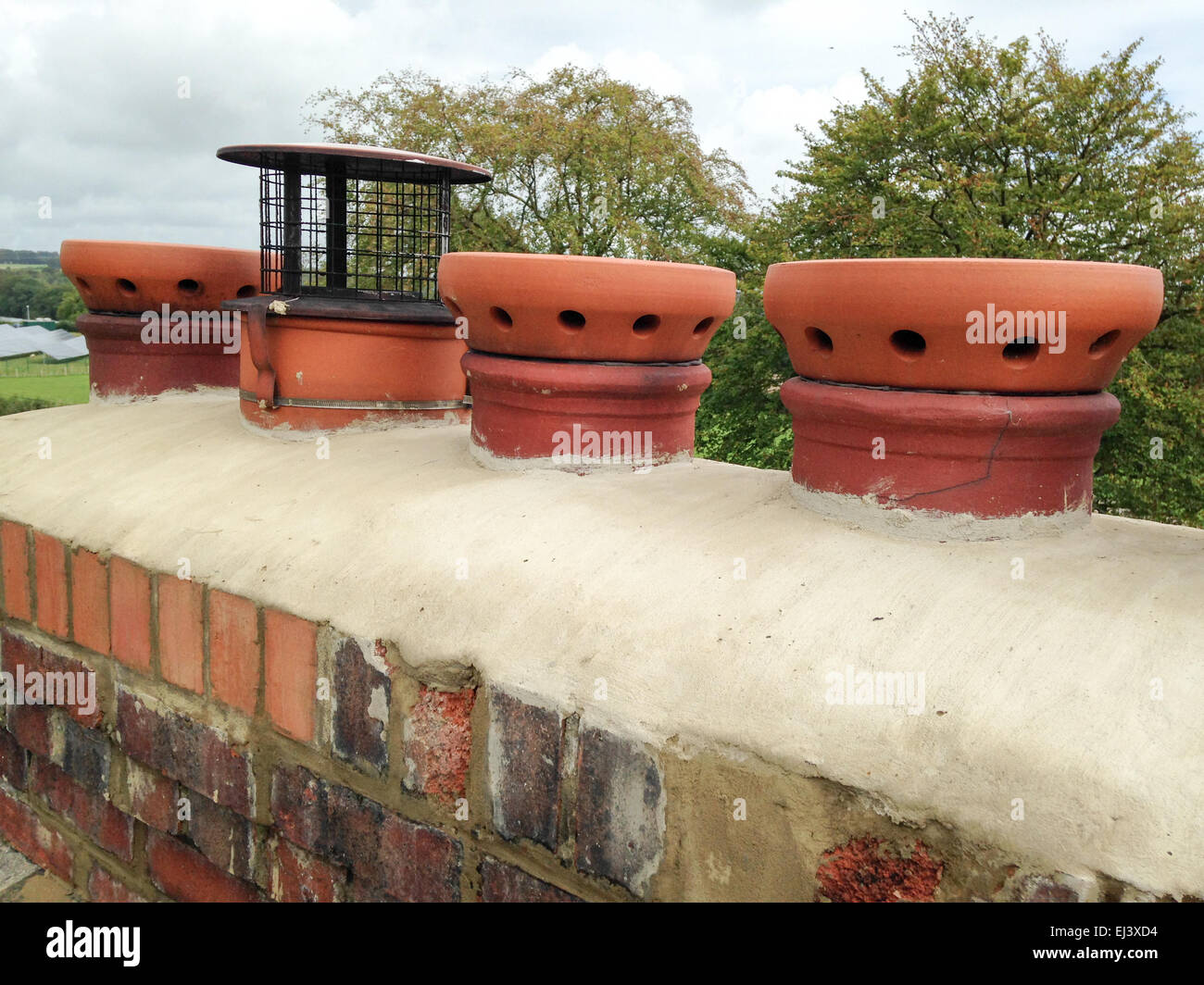 Chimney pots and cowl - Stock Image