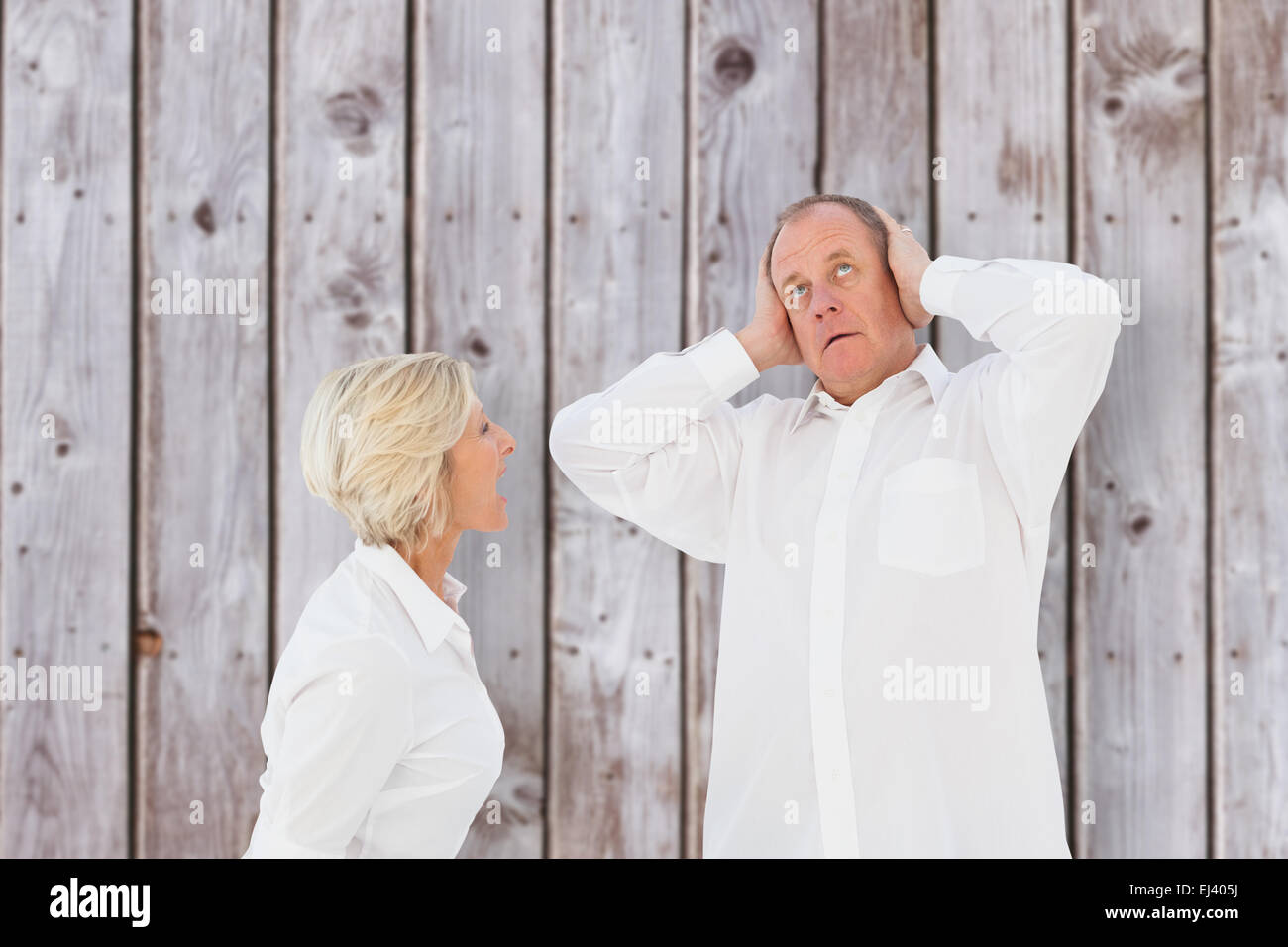 Composite image of angry older couple arguing with each other Stock Photo