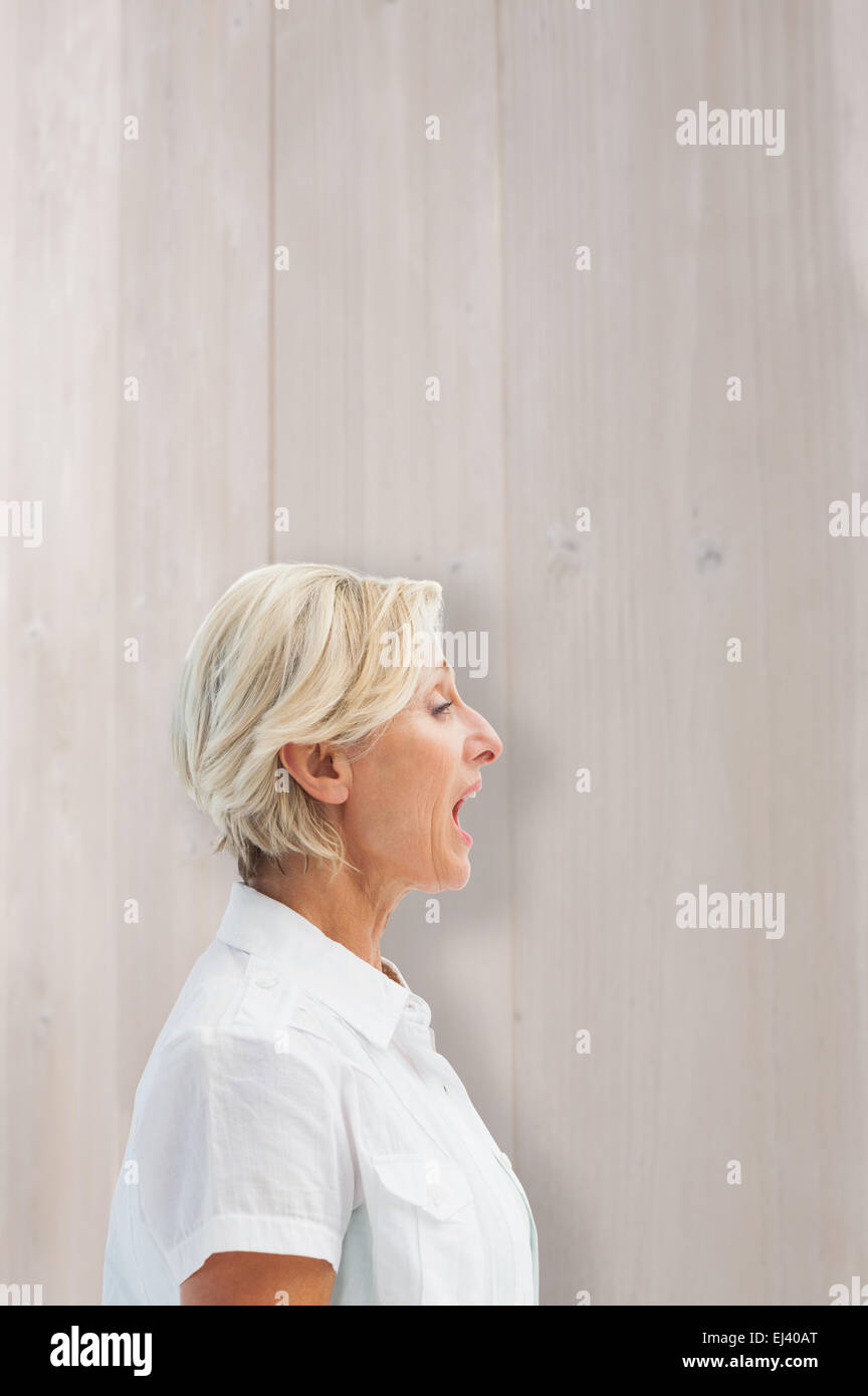 Composite image of happy mature woman talking loudly - Stock Image