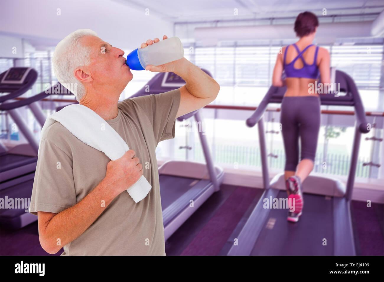 Senior man drinking from water bottle - Stock Image