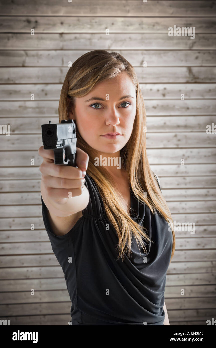 d1dd58a15 Young Pretty Woman Pointing Gun Stock Photos & Young Pretty Woman ...