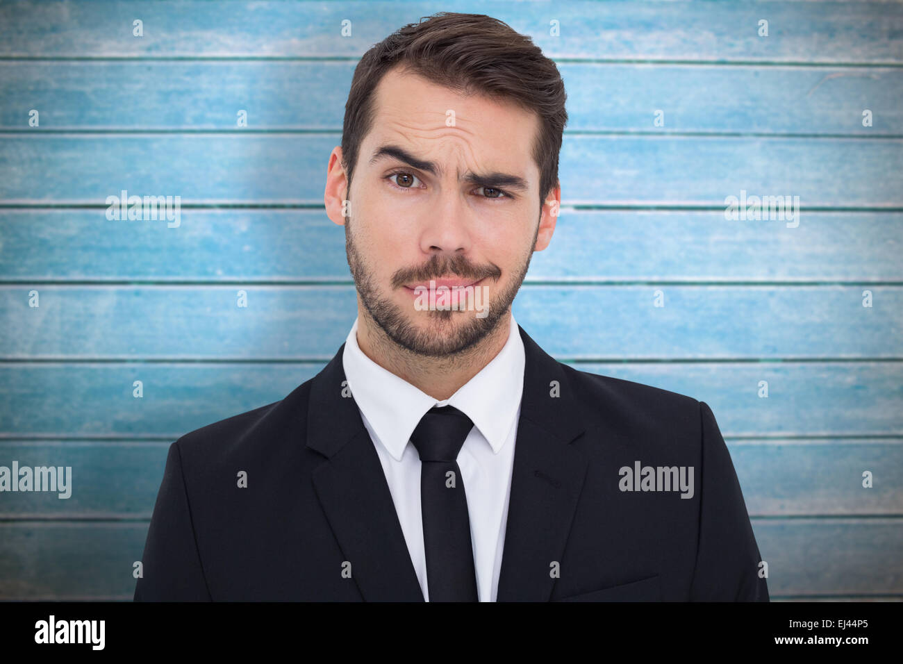 Composite image of portrait of a skeptical businessman well dressed - Stock Image