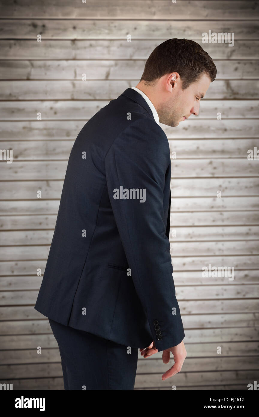 Composite image of businessman bowing - Stock Image