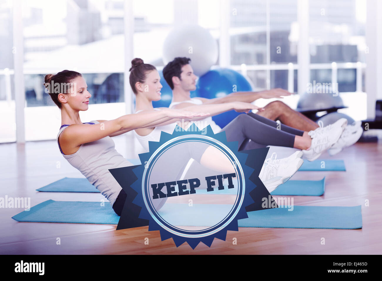 The word keep fit and class stretching on mats at yoga class - Stock Image