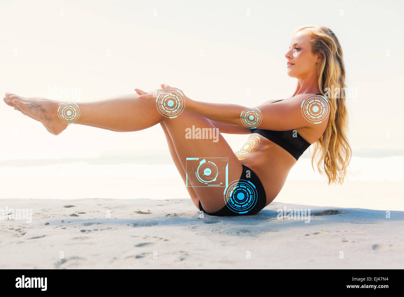 Composite image of fit blonde in core balance pilates pose on the beach - Stock Image