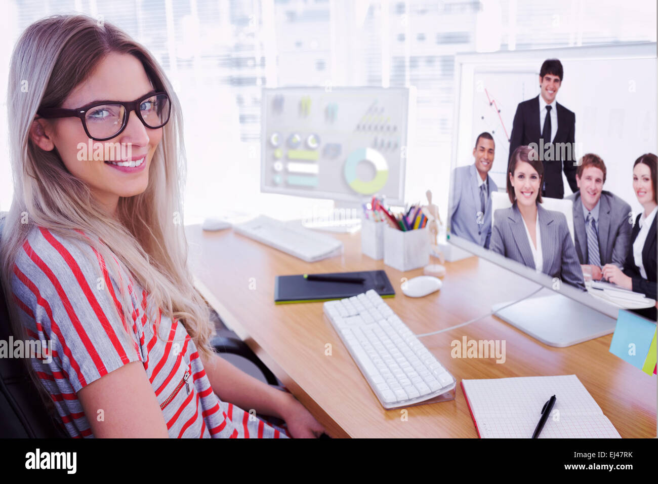 Composite image of attractive photo editor working on computer - Stock Photo