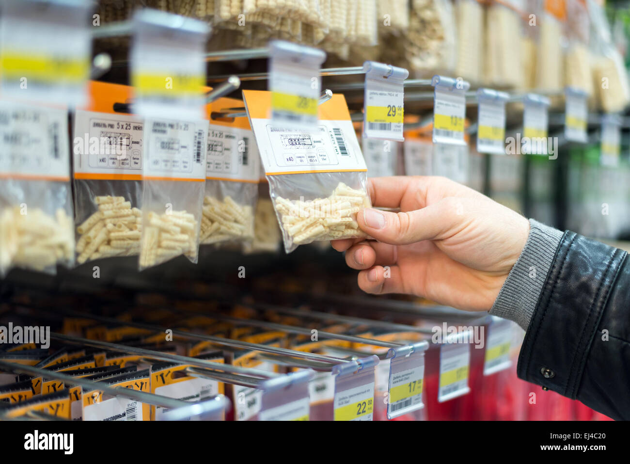 Man chooses dowels in  store - Stock Image