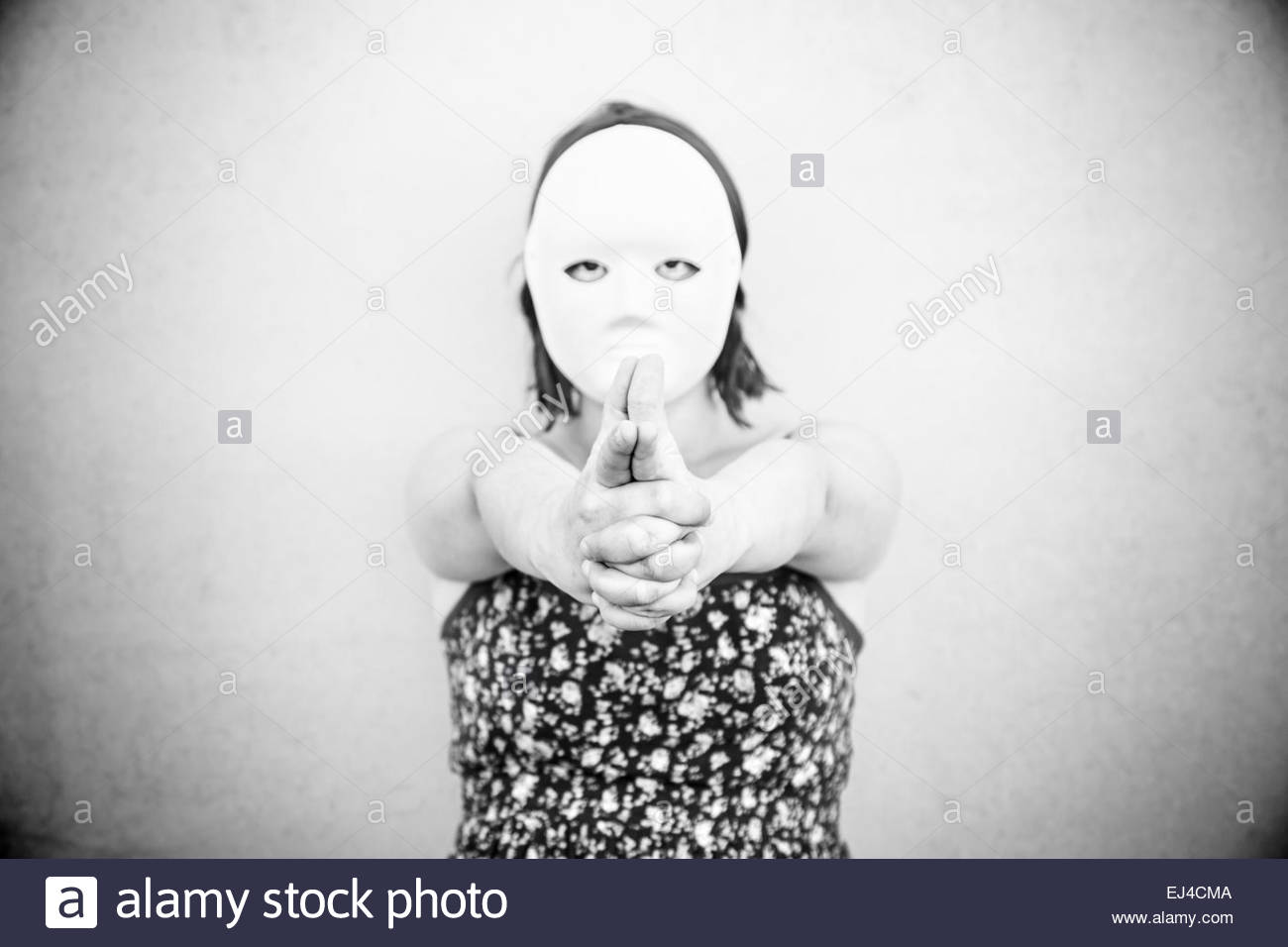 Girl in white mask on halloween, mystery - Stock Image