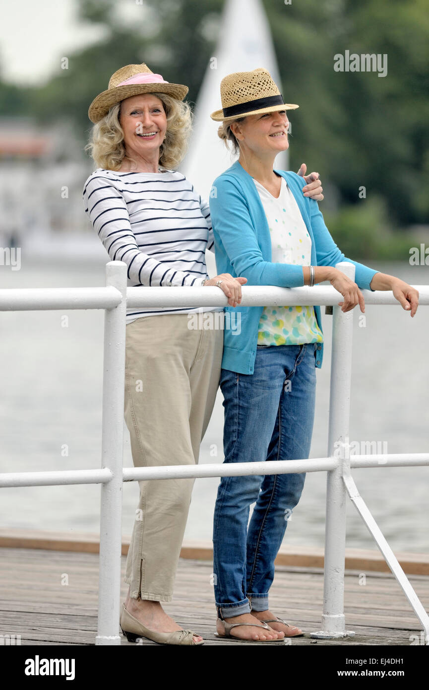 Mother and daughter standing on a landing stage - Stock Image