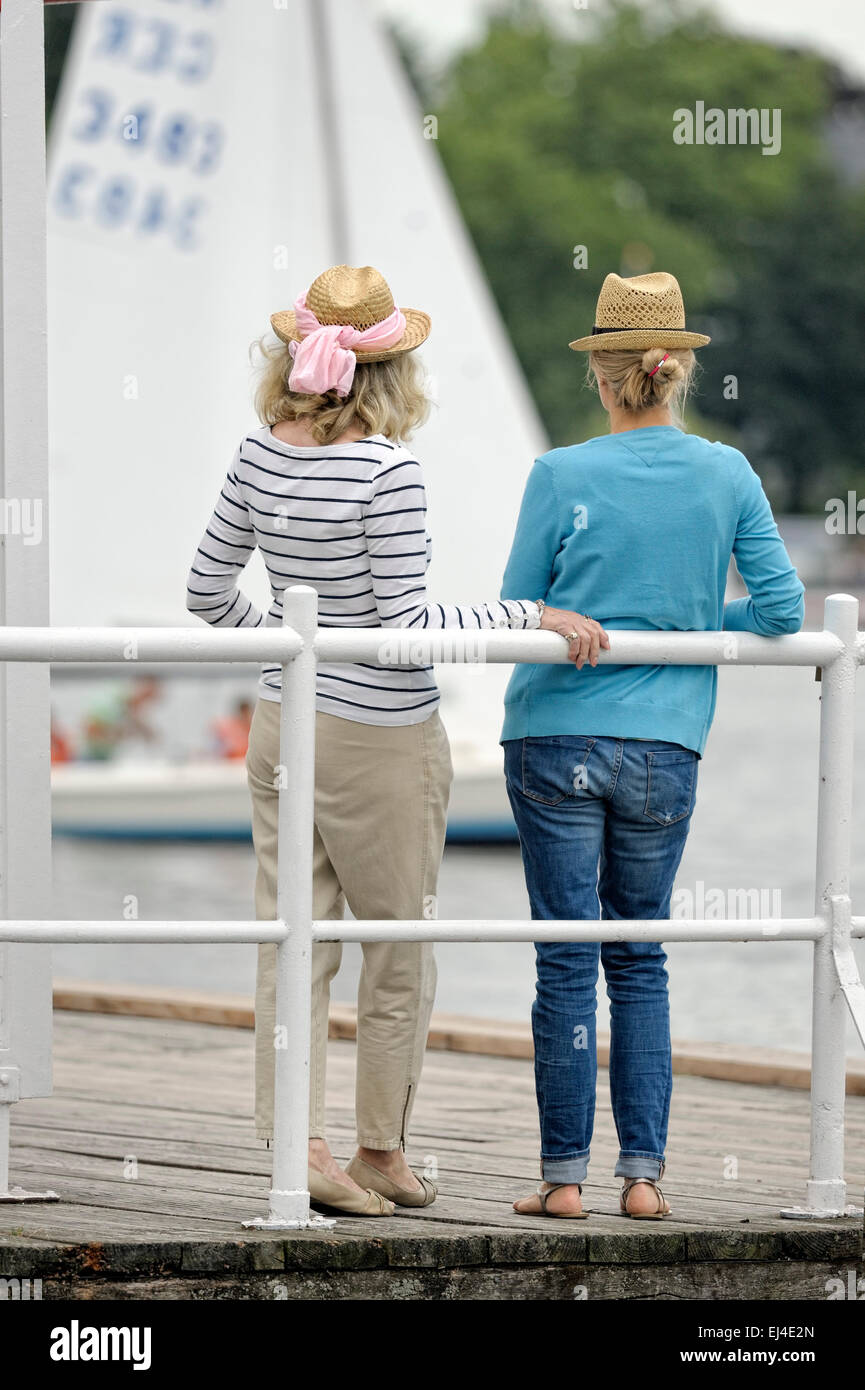 Mother and daughter standing on a landing stage Stock Photo