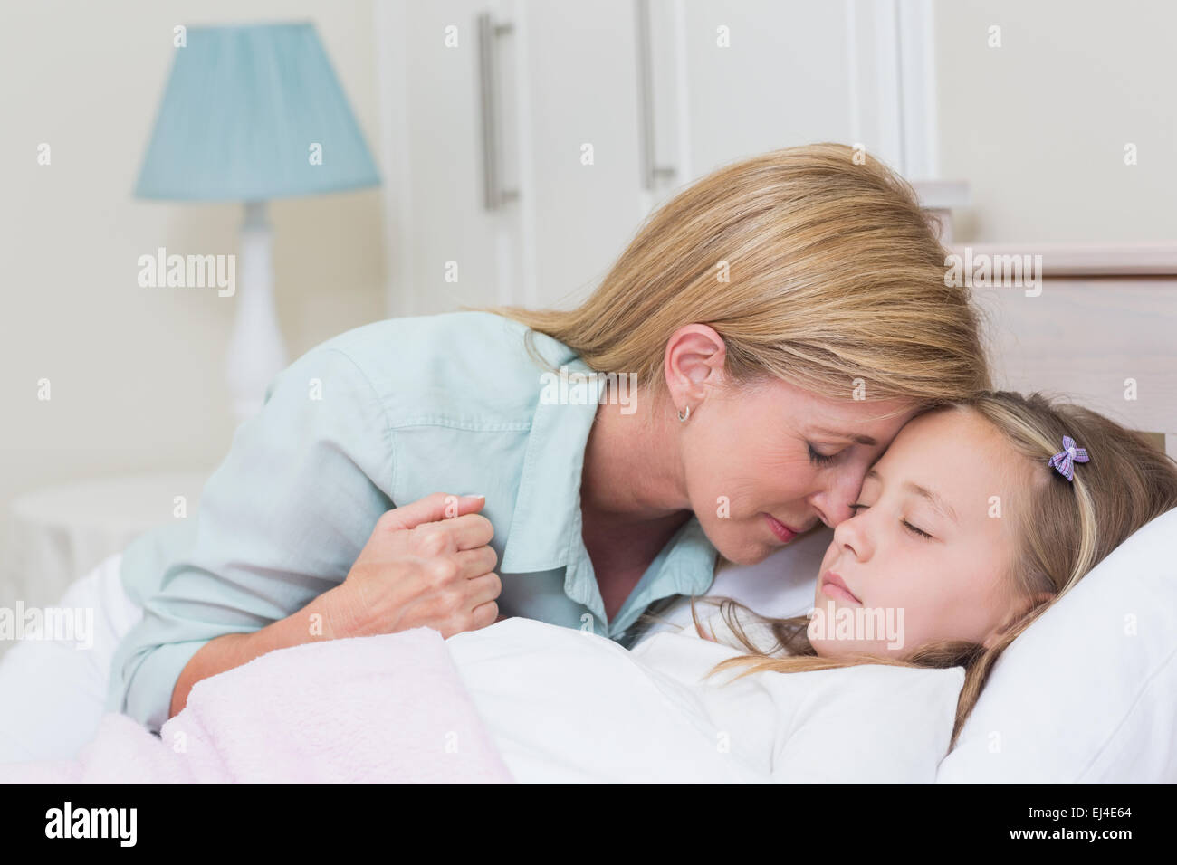 Mother with her slipping daughter - Stock Image
