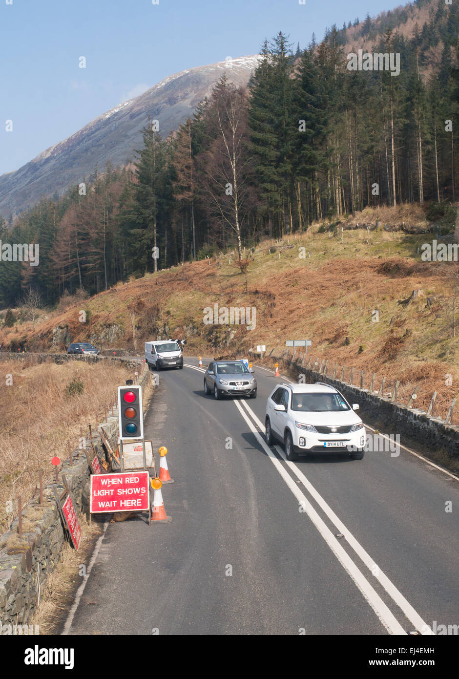 Road Delay Stock Photos Images Alamy In Car Lights Traffic Controlled Single Lane Operation Due To Works Near Thirlmere England Uk