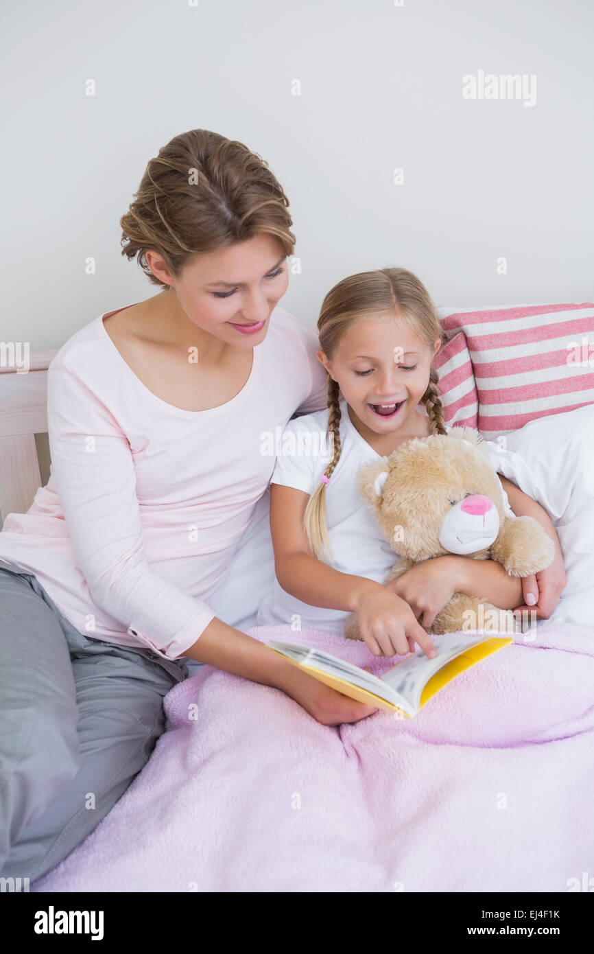 Mother with her daughter at bedtime - Stock Image