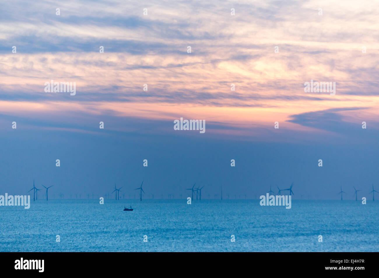 Egmond aan Zee, North Holland, Netherlands, off shore wind park, 18 kilometers of the coast, sunset - Stock Image