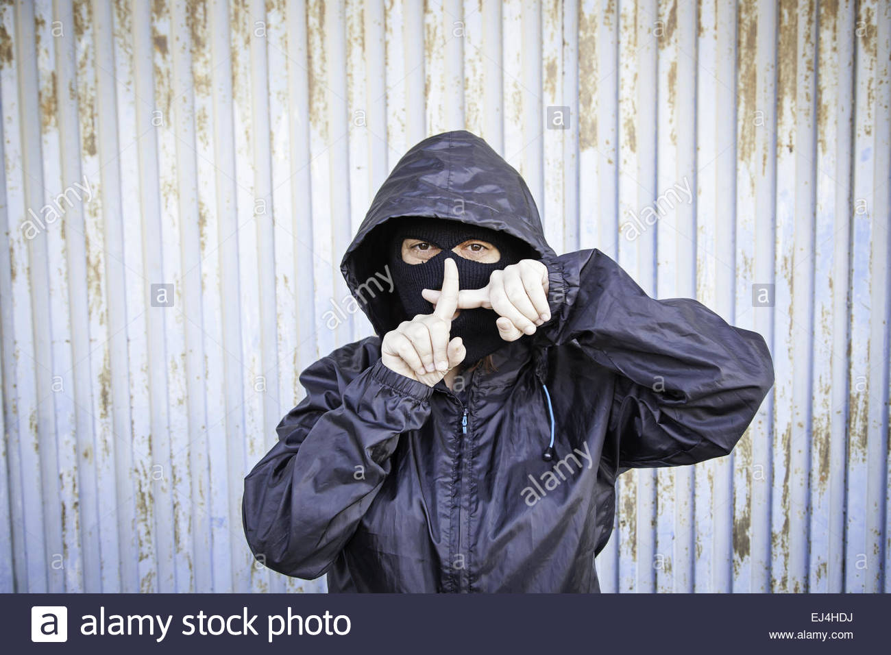 Woman with ski masks and violent hooded mask - Stock Image