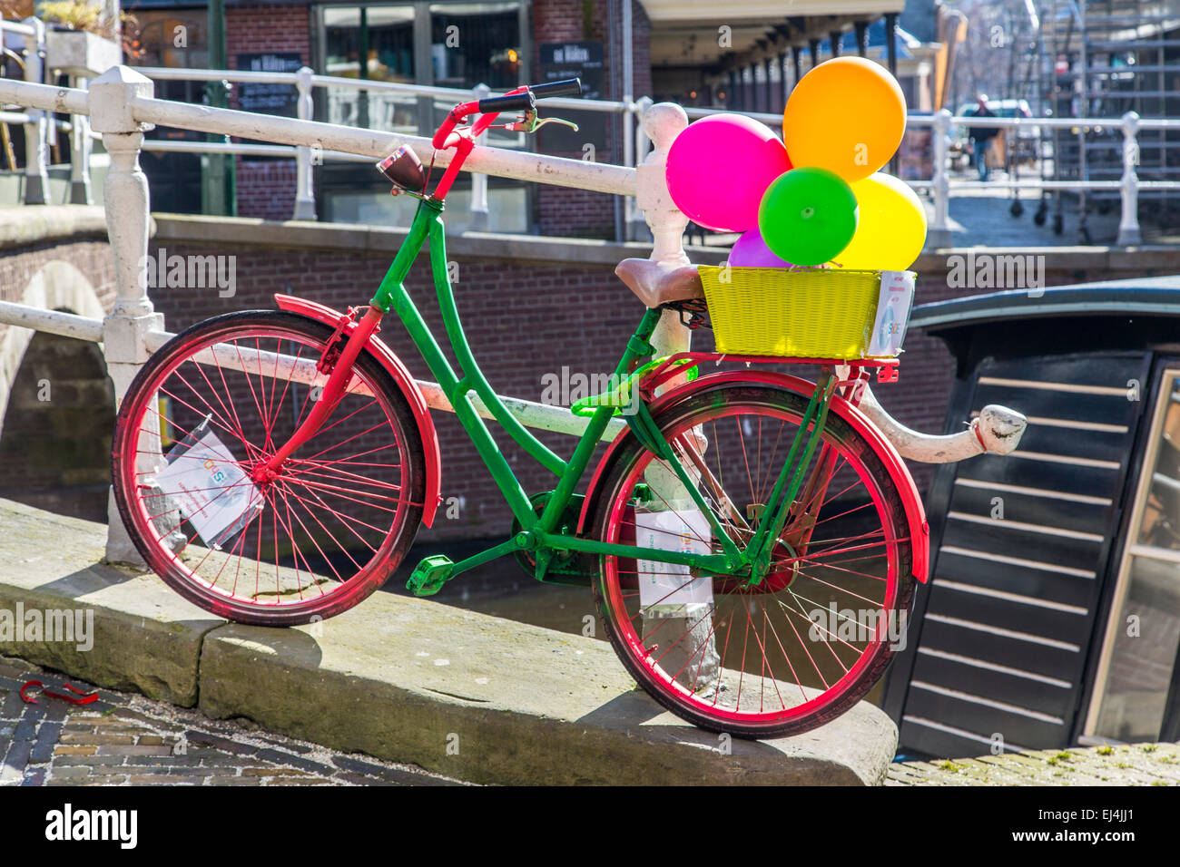 Historic city of Alkmaar, North Holland, Netherlands, dutch bike, colorful, with balloons, - Stock Image