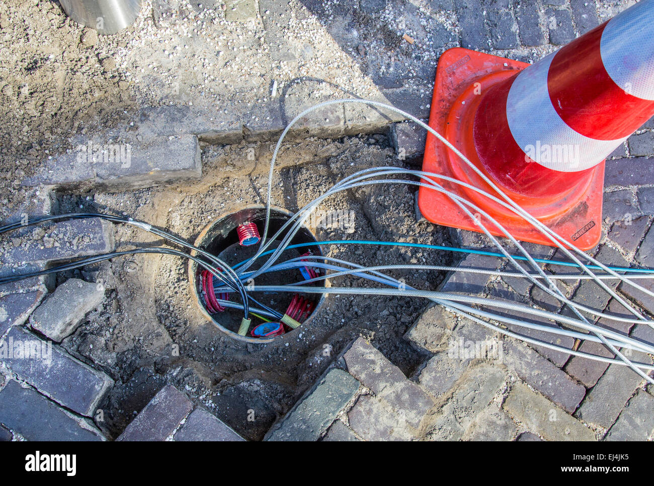 Alkmaar, North Holland, Old Town, cables for telecommunications are laid, fiber optic cable, internet, phone, TV - Stock Image