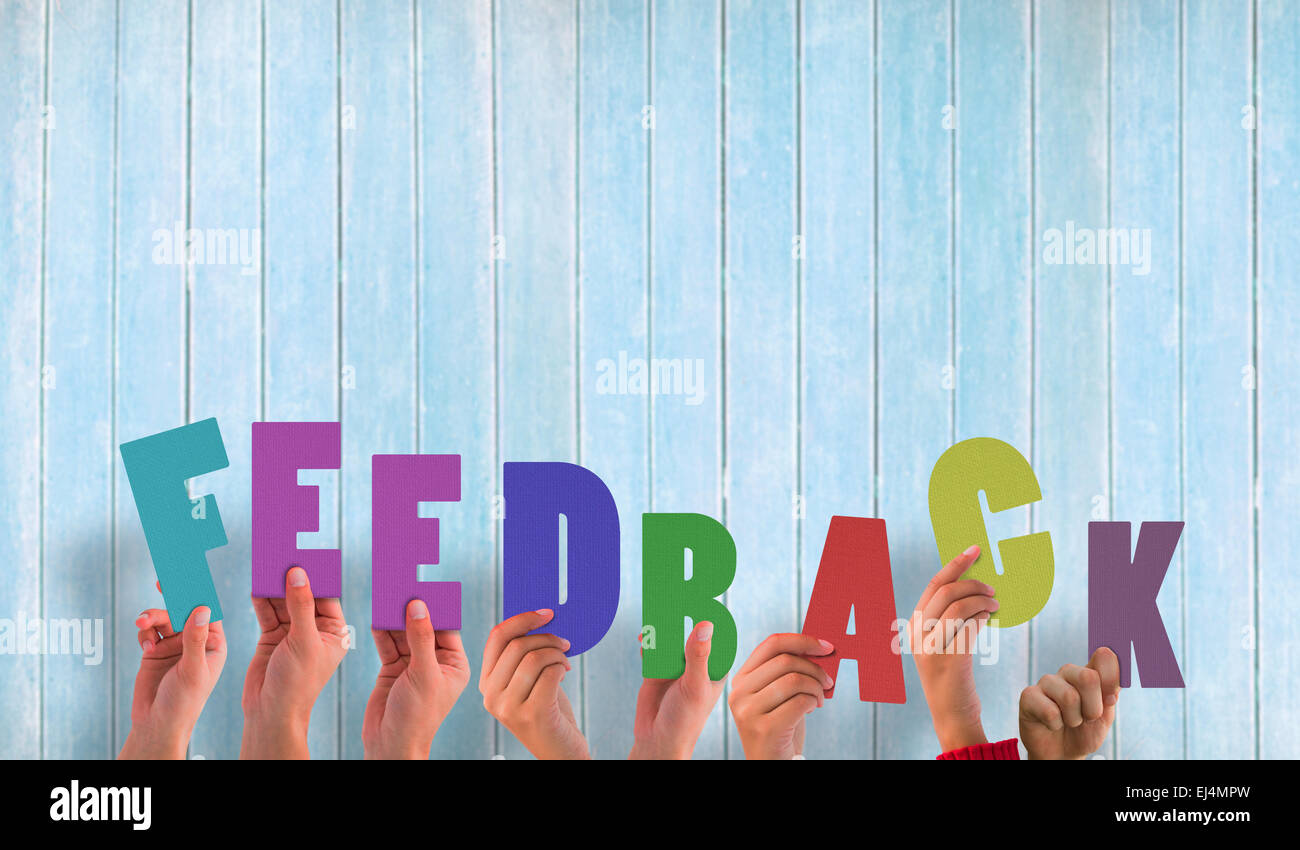 Composite image of hands holding up feedback - Stock Image