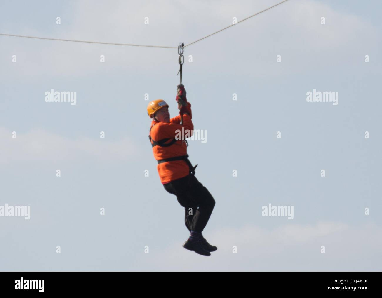 Salford, Greater Manchester UK  21st  March  2015 93 year-old Frank Tolley zip wires across the Manchester Ship Stock Photo