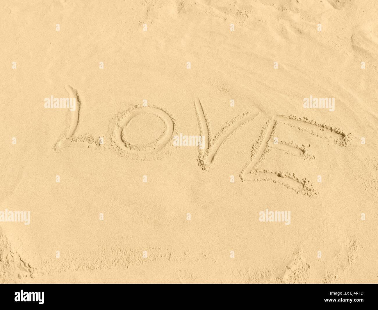 LOVE am Strand in Sand gemalt - Stock Image