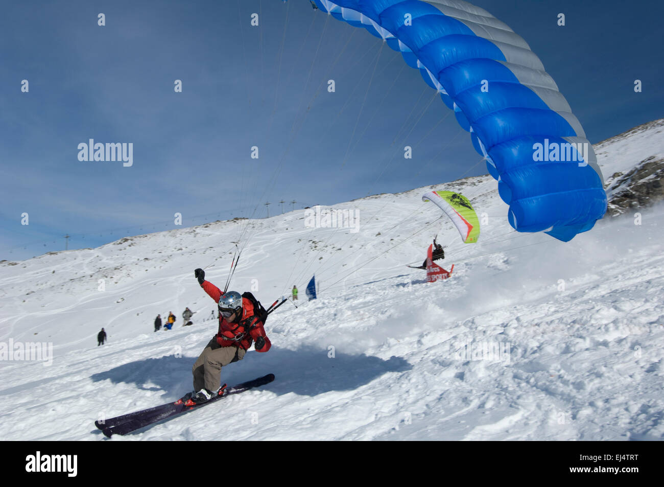 Skiers race in the Columbia Speed Flying Pro event at Les Arcs, France. - Stock Image