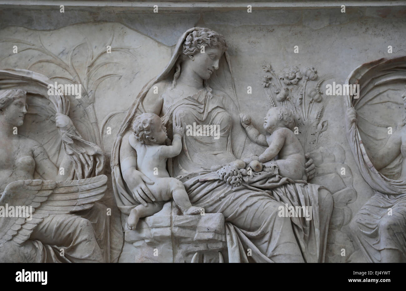 Italy. Rome. Ara Pacis Augustae. A goddess Tellus (Earth) sits amid a scene of fertility and prosperity with twins. - Stock Image