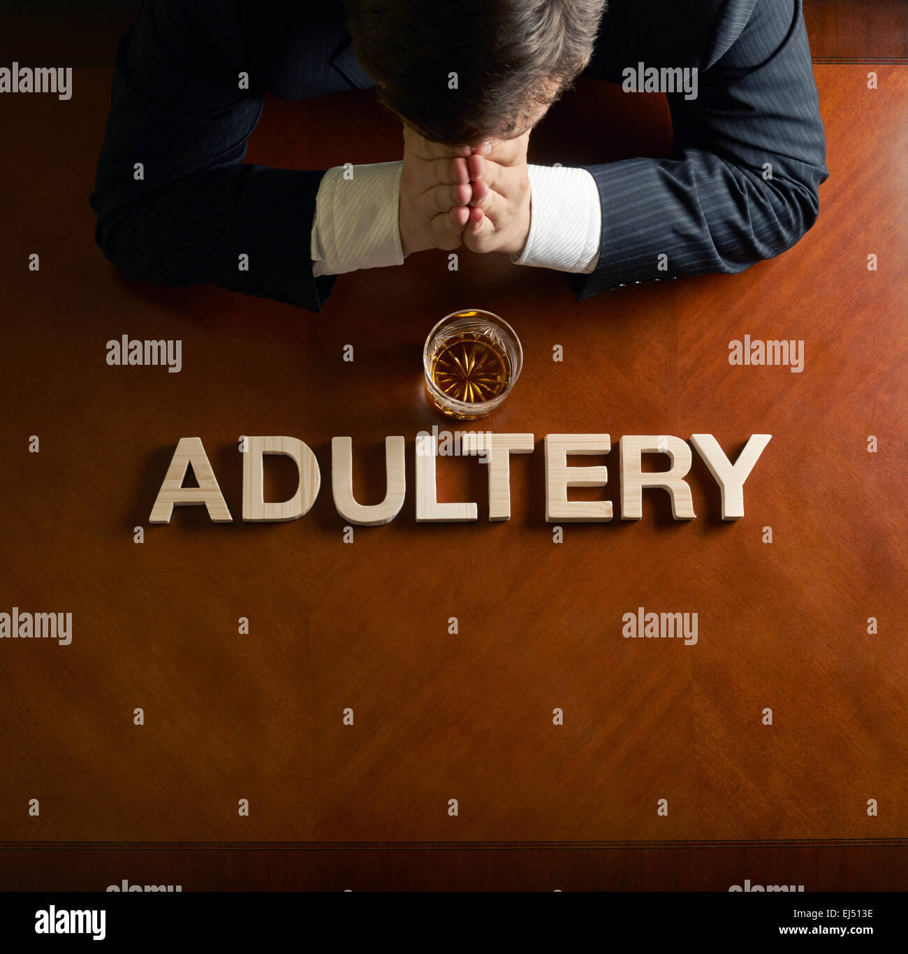 Word Adultery and devastated man composition - Stock Image