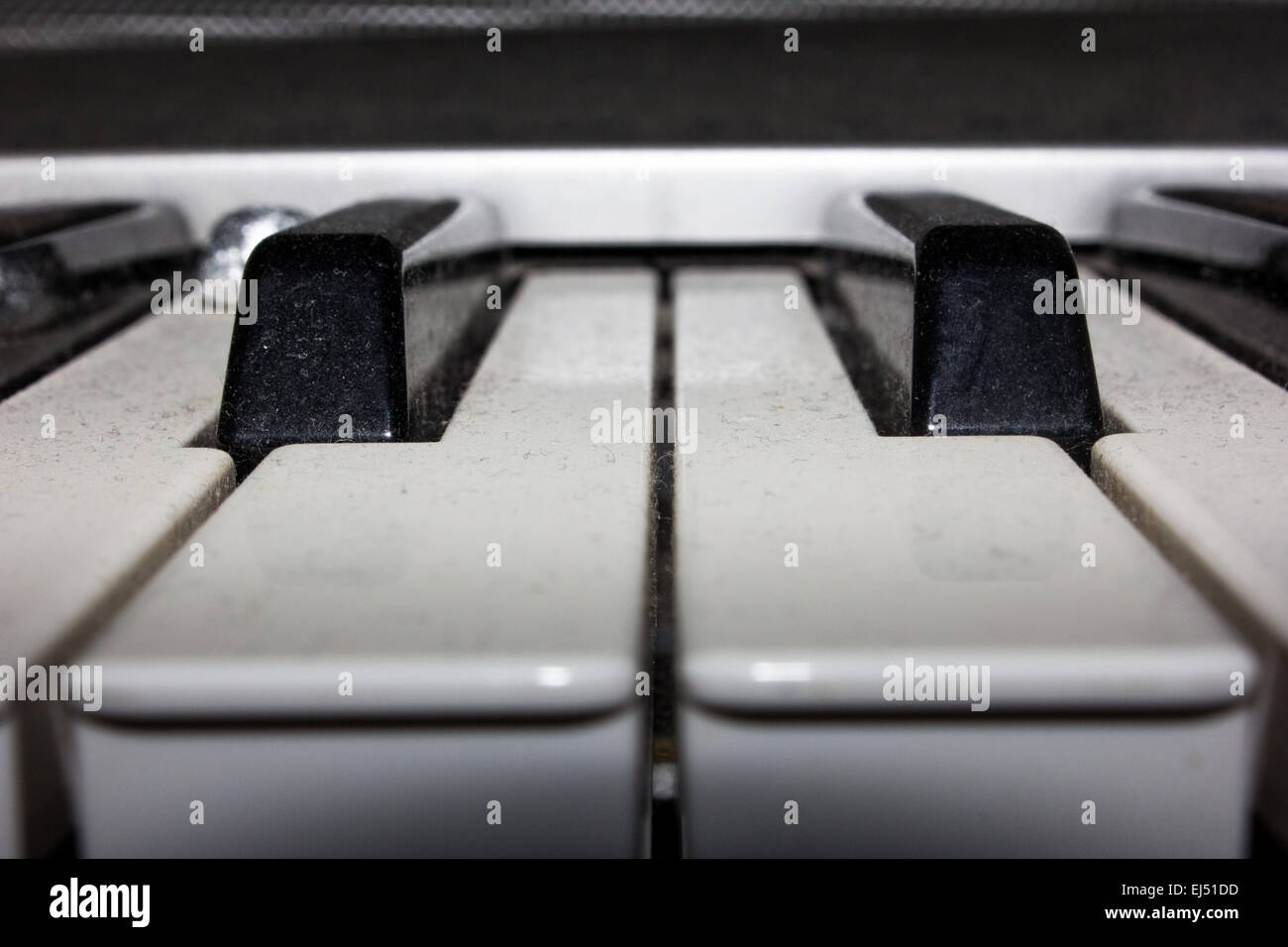 An un-played old, keyboard electric piano which is in desperate need of a dust. - Stock Image