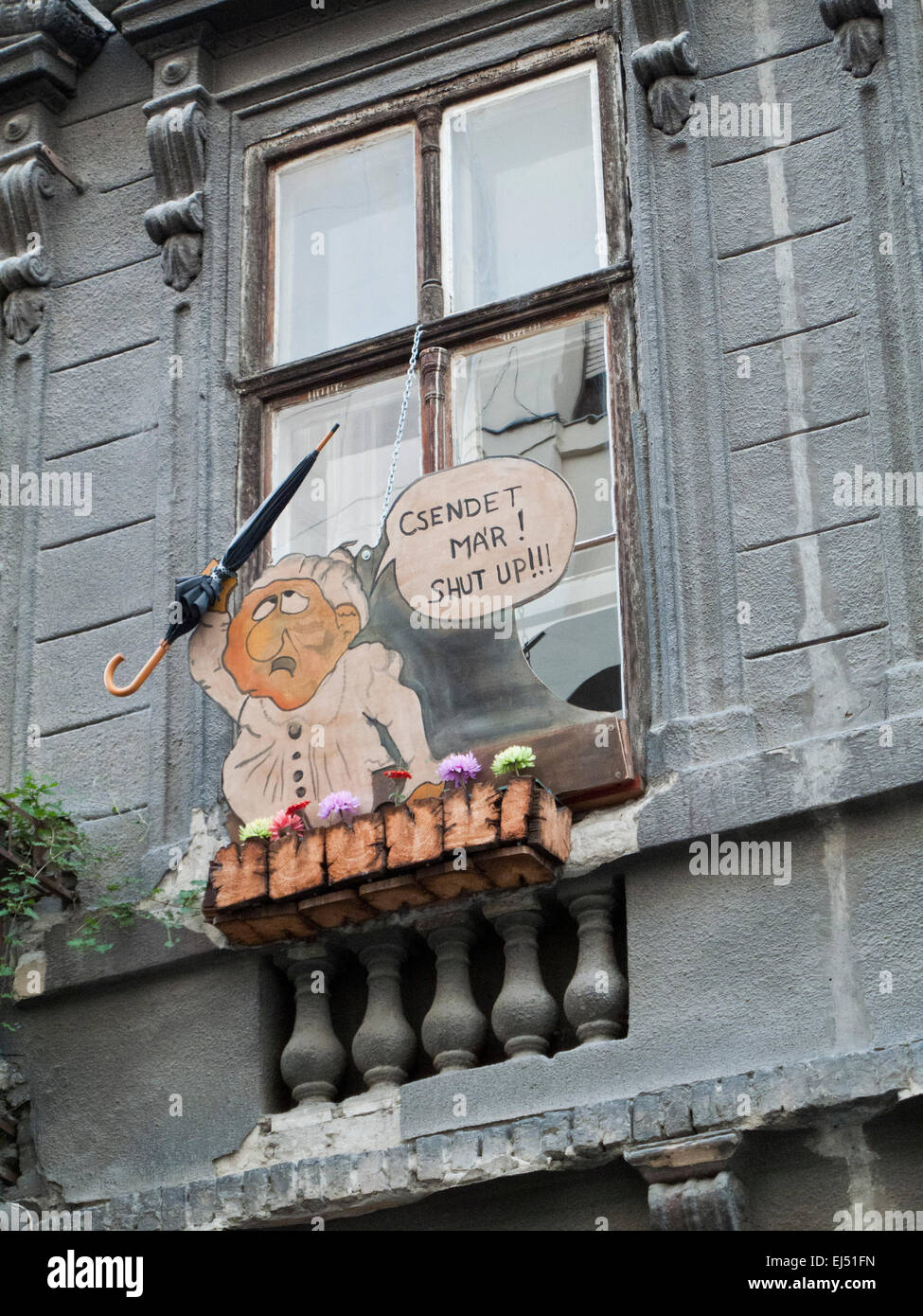 A sign in a window in Budapest, Hungary, telling people in the street to 'shut up' - Stock Image