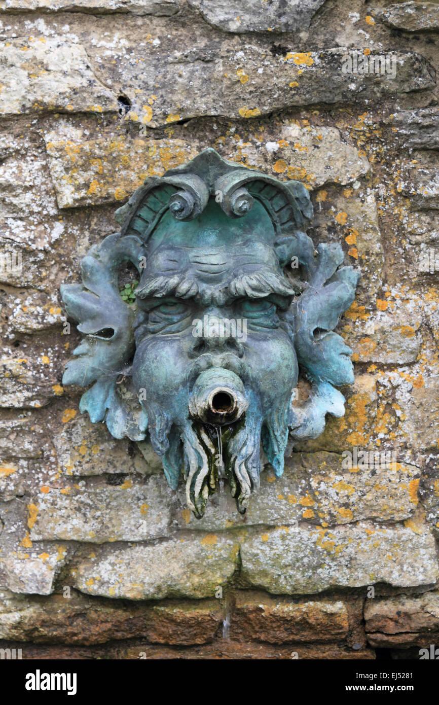 Garden fountain brass mans face - Stock Image