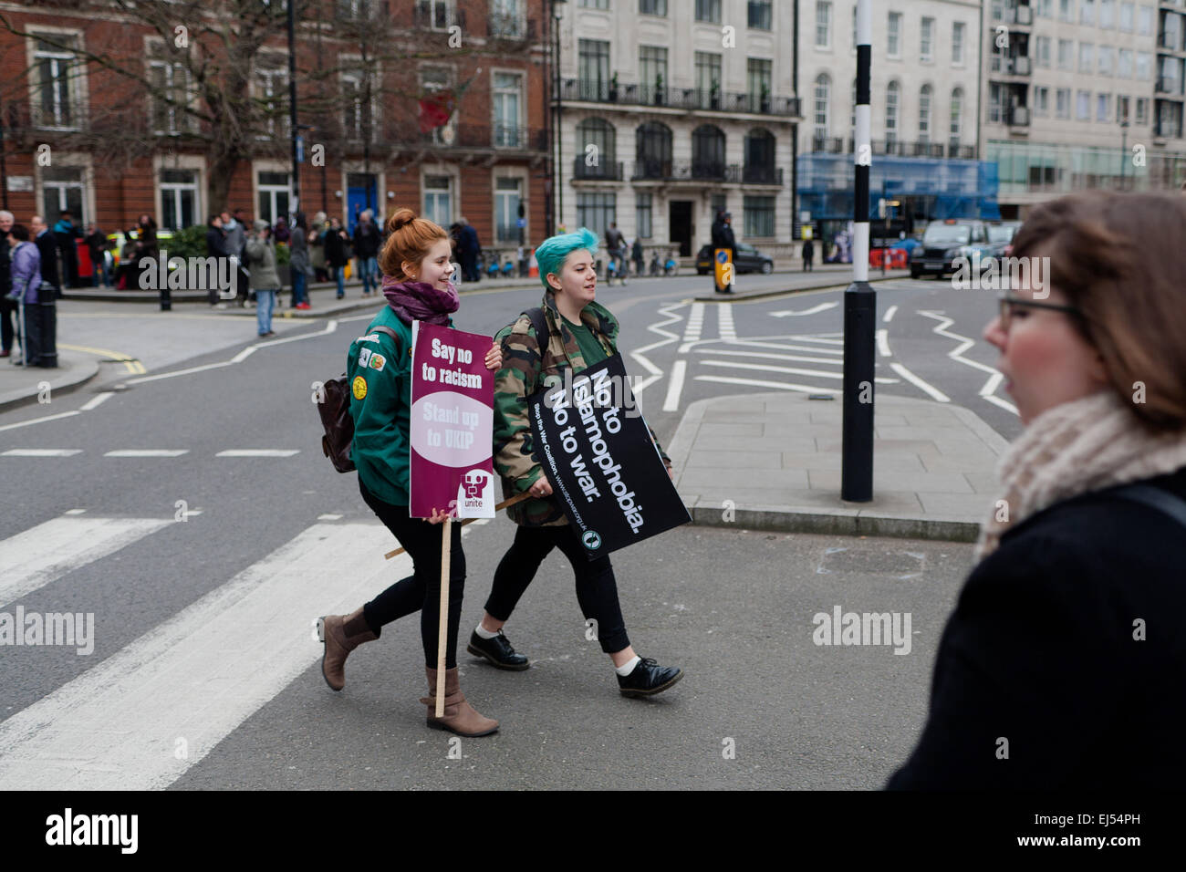 London, UK. 21st March, 2015. Protesters waliking with placard at the Stand up to racism and fascism Protest London, - Stock Image
