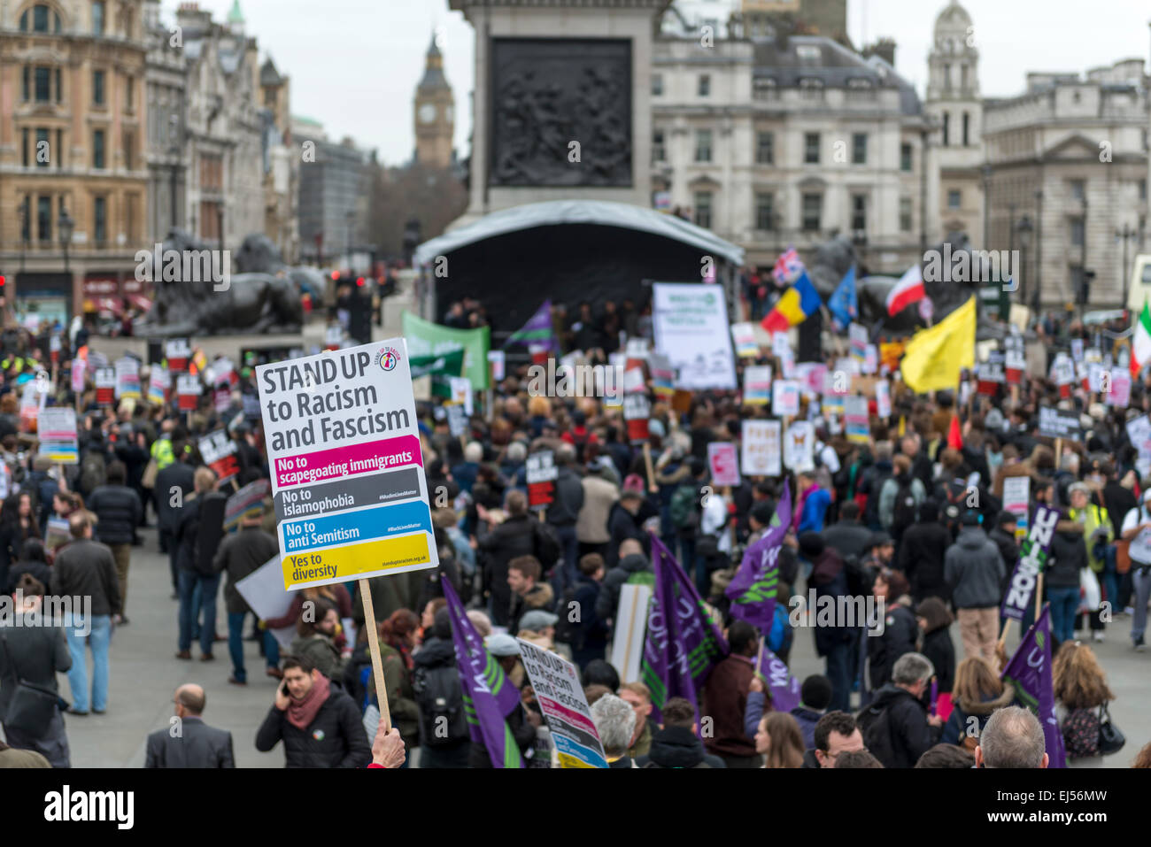 London, 21st March 2015 Anti-racism protesters gather in Trafalgar Square for a rally after a march through London Stock Photo