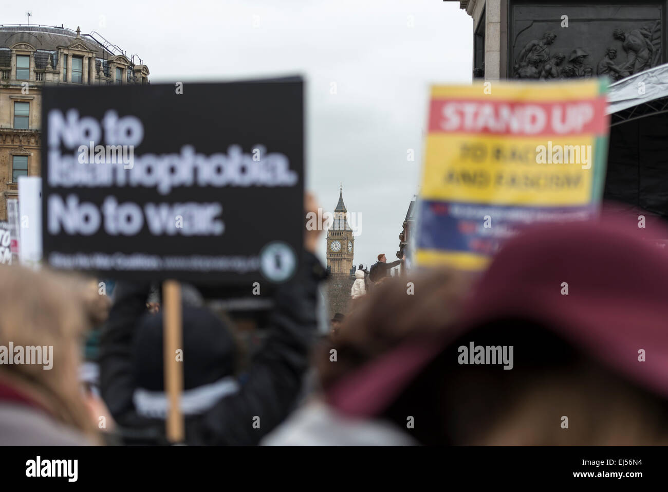London, 21st March 2015 Anti-racism protesters gather in Trafalgar Square with Big Ben in the background - Stock Image