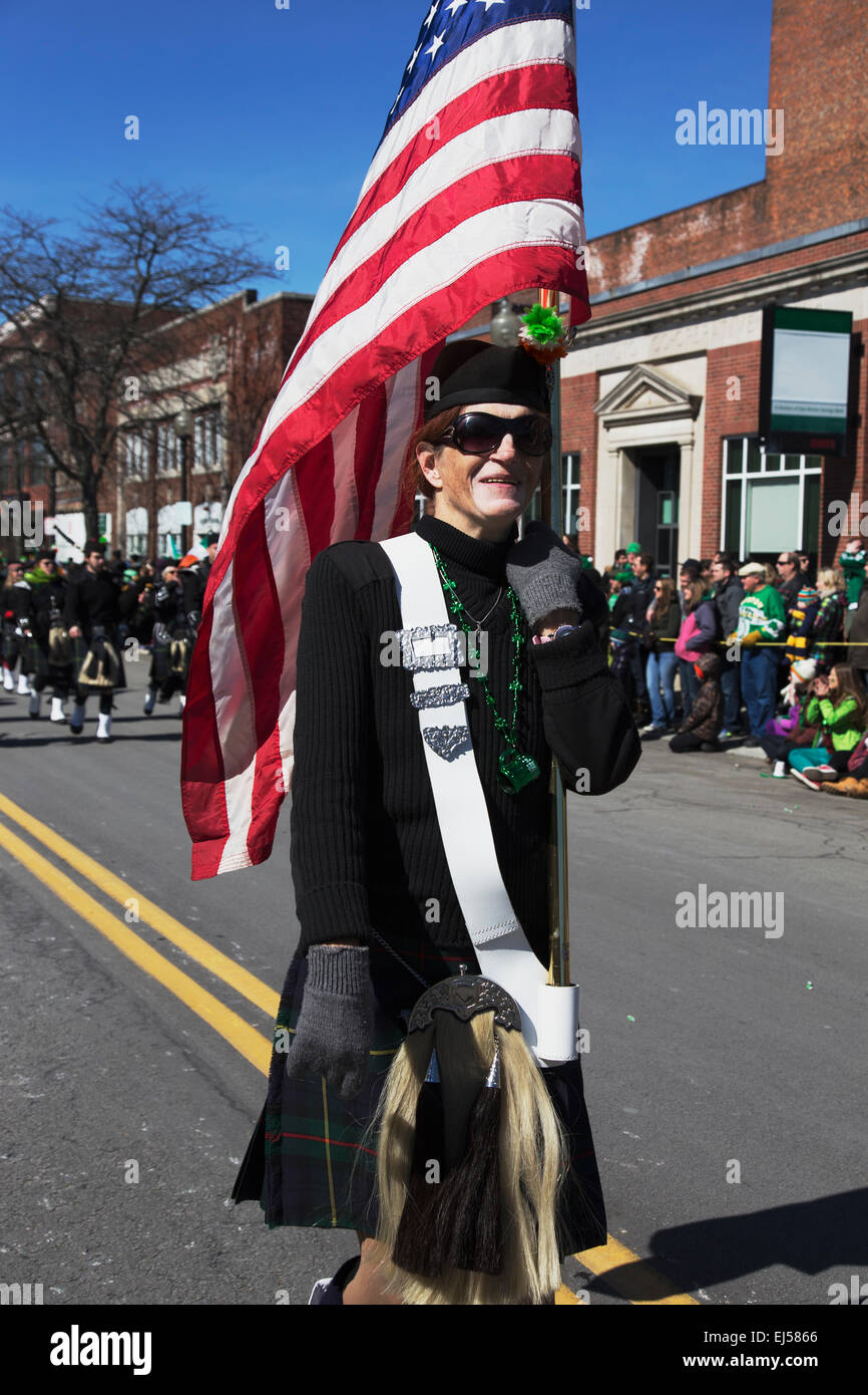 Woman marches with US Flag, St. Patrick's Day Parade, 2014, South Boston, Massachusetts, USA - Stock Image