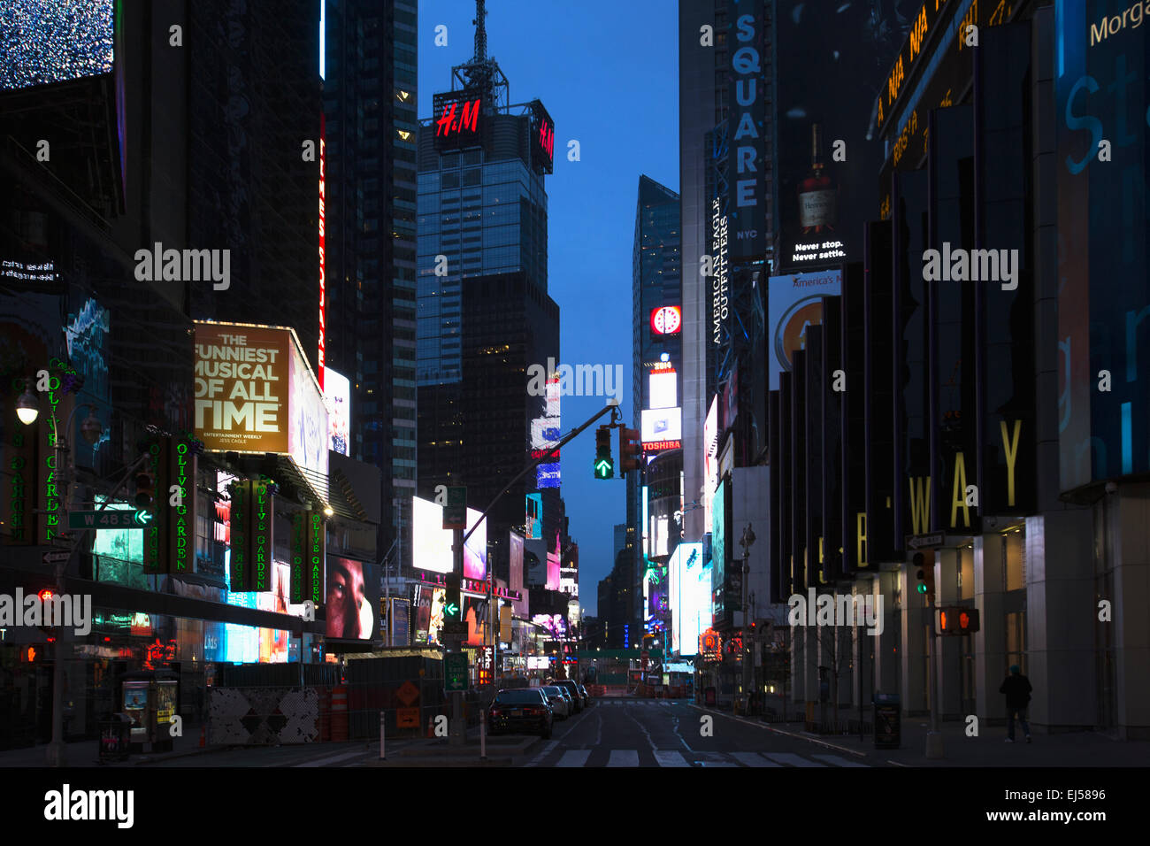 Broadway at dusk shows neon lights, New York, USA - Stock Image