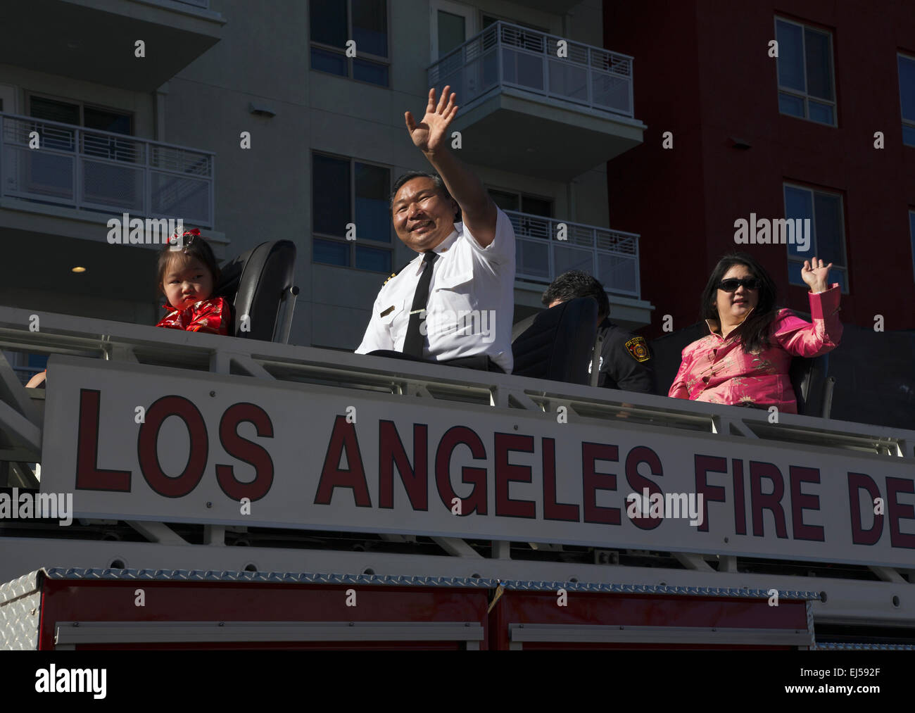 Chinese-American LA Fire Dept waves at 115th Golden Dragon Parade, Chinese New Year, 2014, Year of the Horse, Los - Stock Image