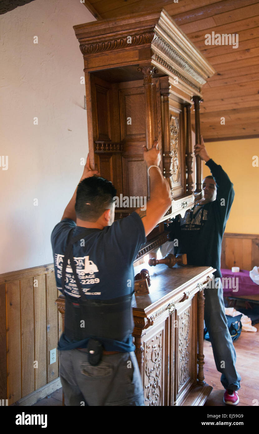 Movers of antique furniture, Pine Mountain Club California - Stock Image