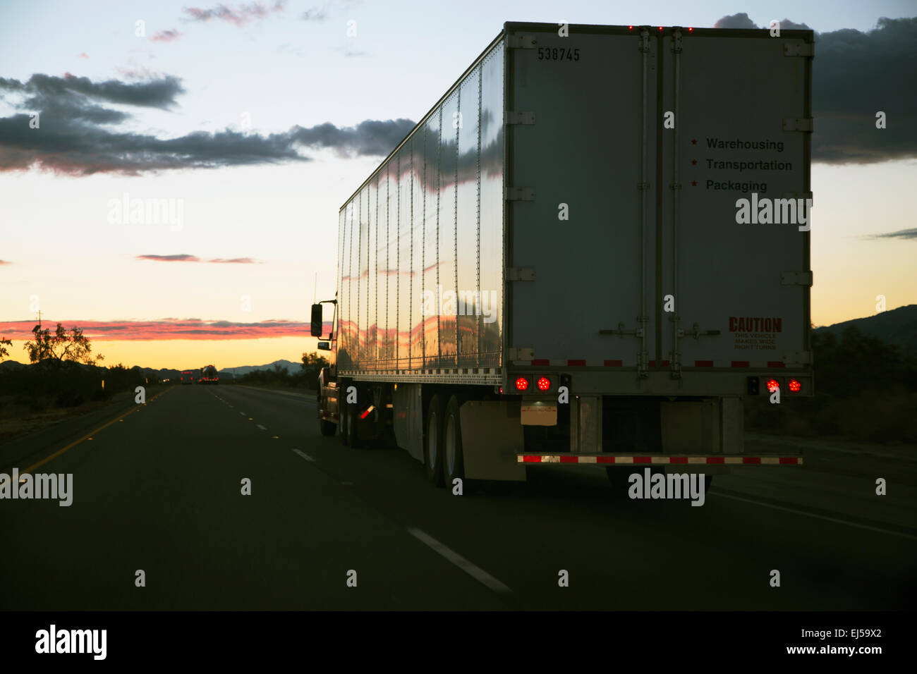 18-wheeler semi-truck drives west on Interstate 10, near Palm Springs, California, USA - Stock Image