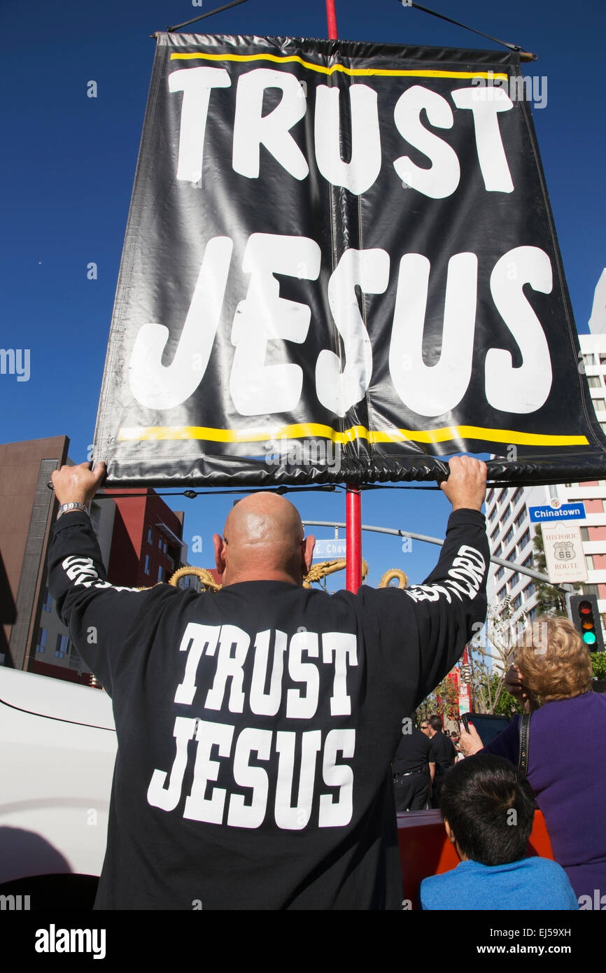 Sign reads 'Trust Jesus' sign, Chinese New Year, Los Angeles, California, USA - Stock Image