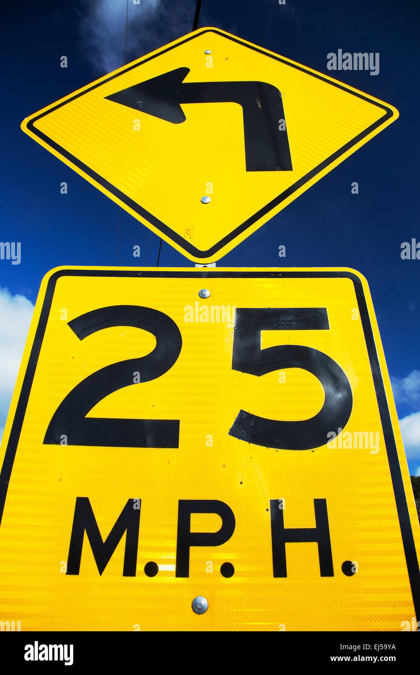 Yellow street sign saying 25 Miles Per House - Stock Image