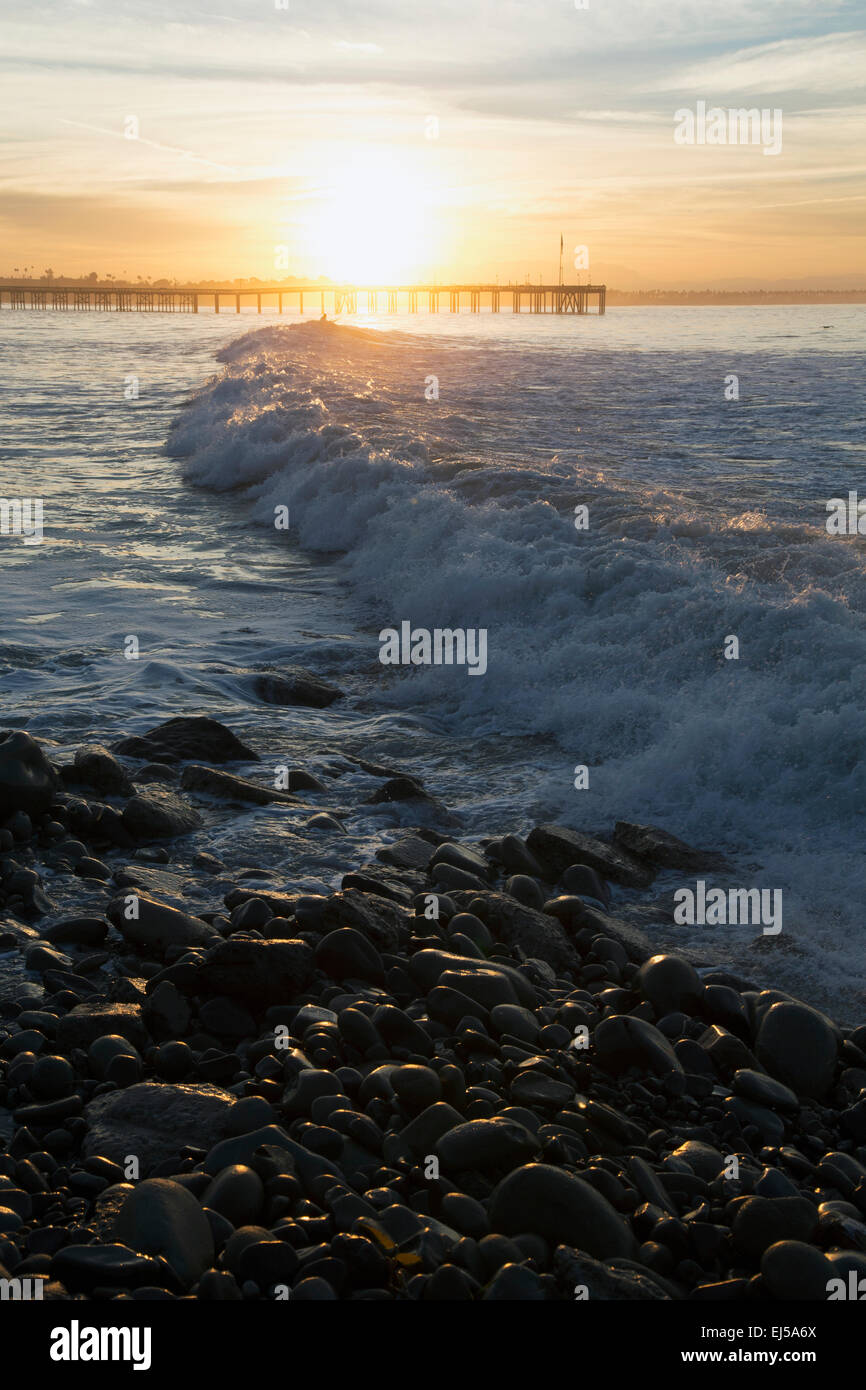 Ocean waves at sunrise with Ventura Pier, Ventura, California, USA Stock Photo