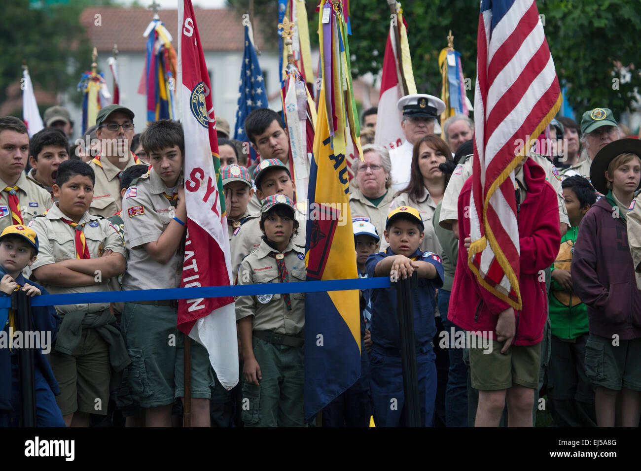 Boyscout Faces and US Flags at solemn 2014 Memorial Day Event, Los Angeles National Cemetery, California, USA - Stock Image