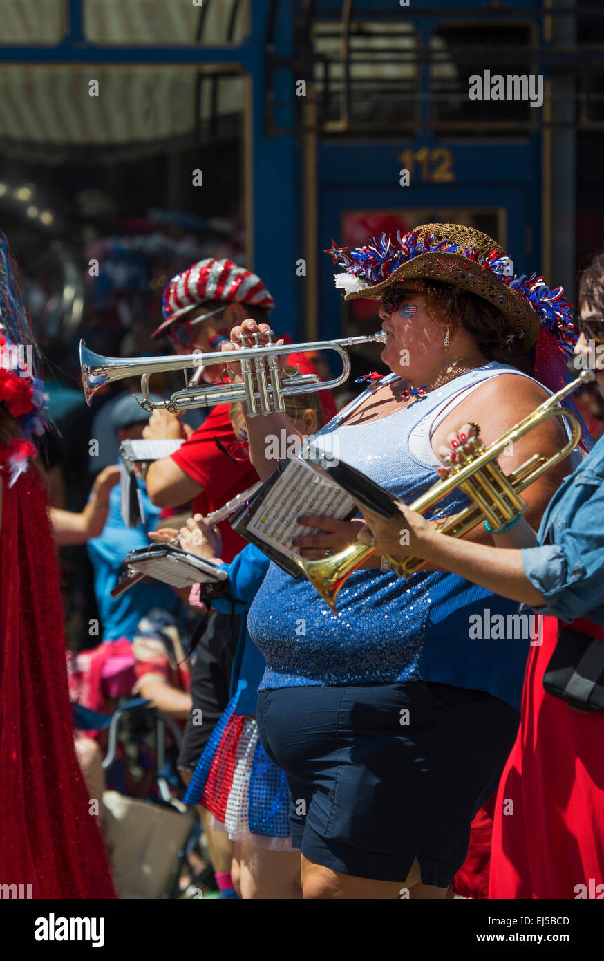 Over weight woman plays trumpet July 4, Independence Day Parade, Telluride, Colorado, USA - Stock Image